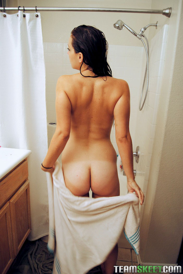 Cute brunette teasing in shower