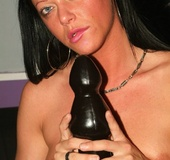 Brutal fisting. Chick riding black dildo.