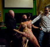 Bdsm sex. Busty brunette gets fucked in front of a bar full of people.