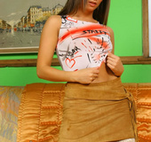 Adult erotic. Sexy Louise wearing a tight top with a miniskirt with white