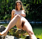 Voyeurporn. Brunette hippie with large breasts and hairy bush outdoors.