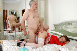 Old young love. Sexy maid clad in red ge - XXX Dessert - Picture 16