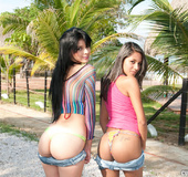 Butt sex. Two young babes get their wet pussies banged poolside.