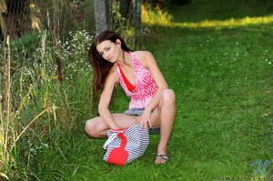 Cute teen relaxes in the grass and decid - XXX Dessert - Picture 5
