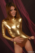 Petite teen beauty in gold latex outfit touching her pussy through it.