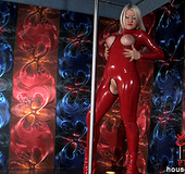 Sexy blonde babe  Monique pole dancing in red latexwear