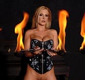 Hot Dorothy Black in latex plays with fire and hot wax