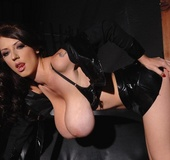 Latex clad babe Merilyn shows her huge F cup boobs to you