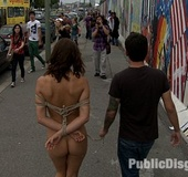 Cute enslaved brunette is captured and used as fuck toy in the public.