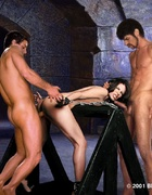 Submission. Two men put hot iron on slave's exhausted body!
