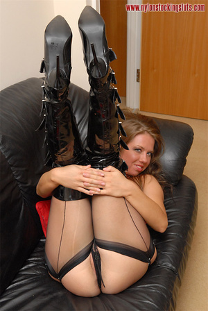 Delicious babe in black nylons taking of - XXX Dessert - Picture 8