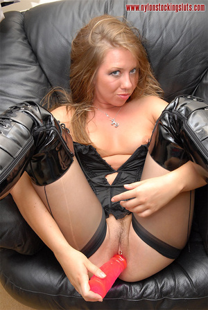 Delicious babe in black nylons taking of - XXX Dessert - Picture 15