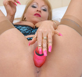 Thick pink dildo penetrating wet pussy of blonde mature chick in awesome
