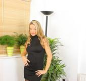 Sexy blonde Jasmine in tight minidress with black pantyhose