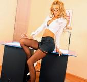Blonde curly hair secretary Lisa Rose in black nylons