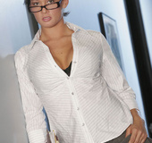 Busty secretary Tory Lane strips at the office