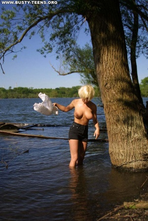 Blonde sporty teen with shows off her at - XXX Dessert - Picture 1