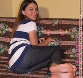 Smily brunette chick in tight jeans willingly exposing her lovely feet.