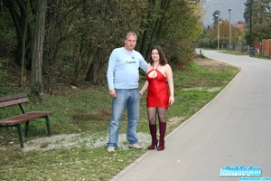 Busty babe in red dress and black stocki - XXX Dessert - Picture 1
