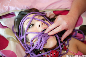 Tape and rope bondaged brunette teen in  - XXX Dessert - Picture 9