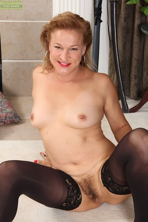 Stripping mature redhead