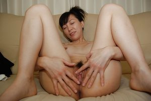 Stripping hairy japanese pussy