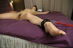 Skinny girl tied up in bedroom