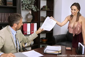 Chesty temptress fucks older man in the office