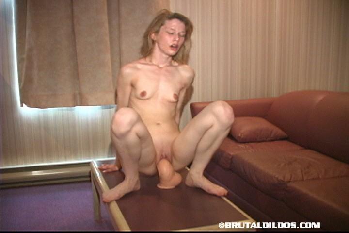 Girl mount dildo on table